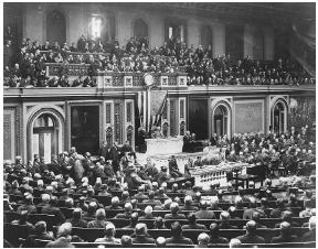 President Woodrow Wilson addresses a joint session of the 64th Congress on February 26, 1917, with a request to arm U.S. merchant ships. LIBRARY OF CONGRESS