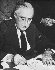 On December 8, 1941, President Franklin Delano Roosevelt signs the Congressional Declaration of War on Japan. NATIONAL ARCHIVES AND RECORDS ADMINISTRATION