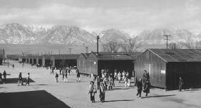 This 1943 photograph by Ansel Adams shows the Manzanar Relocation Center located near Independence, California. The camp was one of ten centers to which Japanese American citizens and Japanese resident aliens were held during World War II. LIBRARY OF CONGRESS