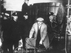 Police seize bootleg liquor during a Prohibition era raid in Detroit, Michigan. NATIONAL ARCHIVES AND RECORDS ADMINISTRATION