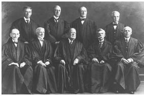 The 1919 Schenck case marked the first time the Court heard a First Amendment challenge to a federal law on free speech grounds. The Court was comprised of the following justices: (standing, l-r) Brandeis, Pitney, McReynolds, Clarke, (seated, l-r) Day, McKenna, White, Holmes, Van Devanter. U.S. SUPREME COURT
