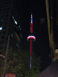 The CN Tower illuminated, as seen from downtown Toronto