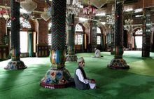 Muslims praying in the male section of a mosque in Srinagar, Jammu and Kashmir.