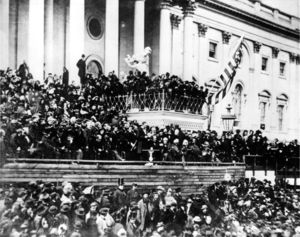 The only known photographs of Lincoln giving a speech were taken as he delivered his second inaugural address. Here, he stands in the center, with papers in his hand.