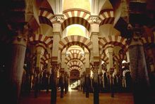Interior of the Mezquita, a hypostyle former mosque with columns arranged in grid pattern, in Córdoba, Spain.