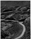 defile - a narrow pass (especially one between mountains)