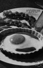 shirred egg - egg cooked individually in cream or butter in a small ramekin