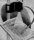 microfilm - film on which materials are photographed at greatly reduced size