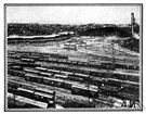 railyard - an area having a network of railway tracks and sidings for storage and maintenance of cars and engines