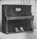 Player piano - a mechanically operated piano that uses a roll of perforated paper to activate the keys