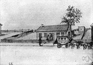 remise - a small building for housing coaches and carriages and other vehicles