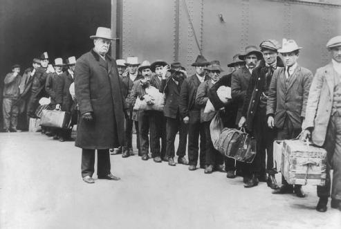 Emigration is the act of leaving one's country to live somewhere else. These men emigrated from Italy to the United States in 1911. LIBRARY OF CONGRESS