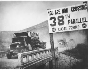 A convoy of U.S. Army trucks cross the 38th parallel during the Korean War. The parallel marks the dividing line between North and South Korea. NATIONAL ARCHIVES AND RECORDS ADMINISTRATION