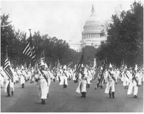 Ku Klux Klan members parade in Washington, D.C., during the 1920s, a decade in which Klan membership grew into the millions and the group exerted significant political influence. LIBRARY OF CONGRESS