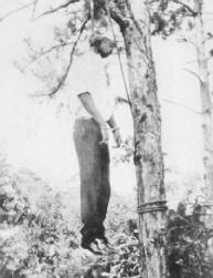 An African American victim of a 1928 lynching. Between 1880 and 1930, an estimated 2,400 black men, women, and children were killed by lynch mobs. LIBRARY OF CONGRESS
