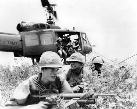 American soldiers exit a helicopter during Operation Oregon in the Vietnam War. More than 47,000 U.S. military personnel were killed in action during the war. U.S. DEPARTMENT OF DEFENSE