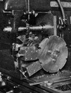 milling machine - machine tool in which metal that is secured to a carriage is fed against rotating cutters that shape it