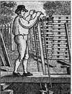 sawpit - a pit over which lumber is positioned to be sawed by two men with a long two-handed saw