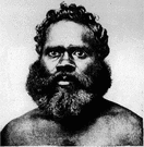 Åbo - a dark-skinned member of a race of people living in Australia when Europeans arrived