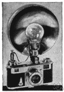 photographic camera - equipment for taking photographs (usually consisting of a lightproof box with a lens at one end and light-sensitive film at the other)