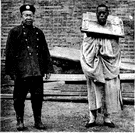 cangue - an instrument of punishment formerly used in China for petty criminals